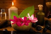 stock photo of frangipani  - Spa setting with frangipani flower - JPG