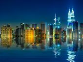 Kuala Lumpur is the capital and the largest city of Malaysia, view with water reflection.
