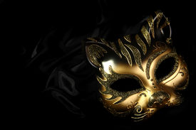 picture of masquerade mask  - ornate carnival mask over black silk background - JPG