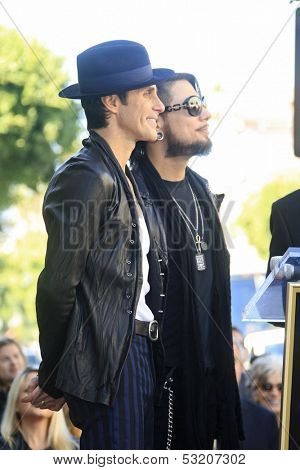 LOS ANGELES - OCT 30: Perry Farrell, Dave Navarro at a ceremony where 'Jane's Addiction' was honored with a star on the Hollywood Walk of Fame on October 30, 2013 in Los Angeles, California