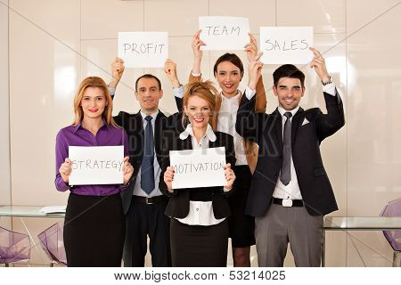 Team Of Business People Holding Cardboards