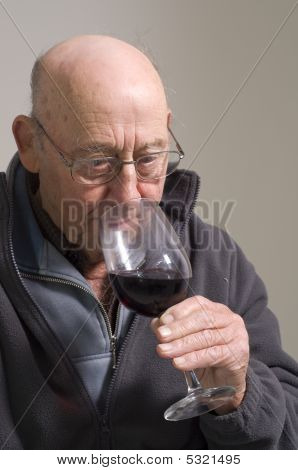 Senior Man With Glass Of Red Wine