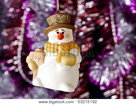 Happy Christmas Snowman, Tinsel As Background. Selective Focus
