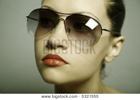Young Pretty Woman With Glasses