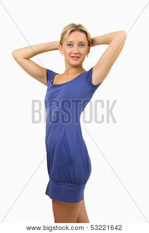 Woman In Short, Skin-tight, Blue Dress, Holds Hands Behind Her Head.