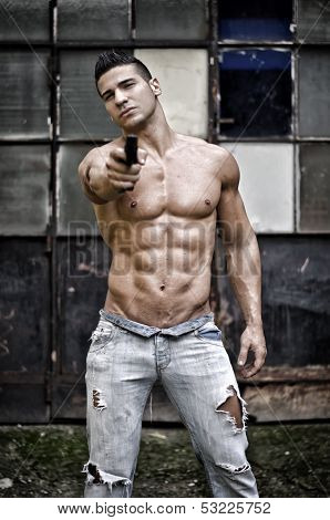 Muscular Young Man Shirtless Pointing Gun To Camera