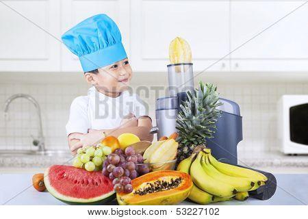 Asian Boy Making Fruit Juice