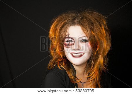 Halloween. Make-up On A Face Of The Young Woman