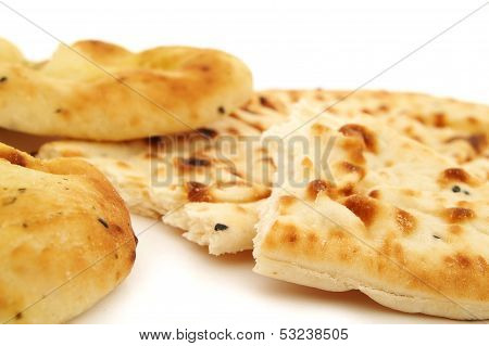 traditional Indian Naan flat bread on white