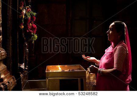 Madurai, India - February 16: Indian Woman In Colorful Sari Prays Inside Meenakshi Temple On Februar