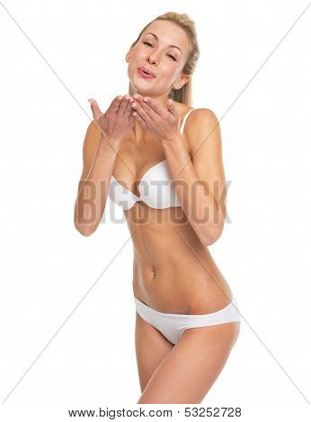 Happy Young Woman In Lingerie Blowing Air Kiss