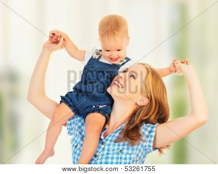 Happy Family. Baby Sits Astride The Shoulders Of The Mother