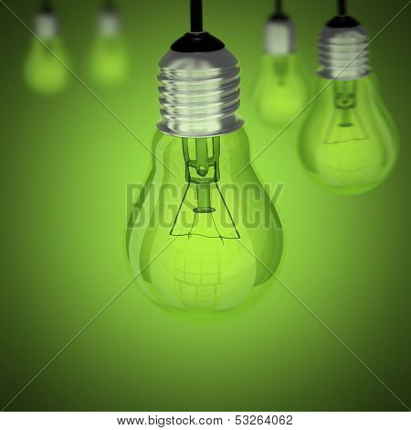 Turned Off Light Bulb On Green Background