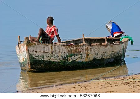 A mozambican fisherman sitting on a fishing boat