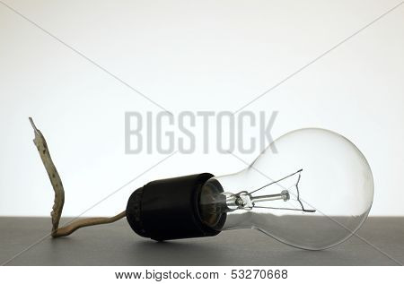 Light Bulb Installed Into Grubby Lamp Socket