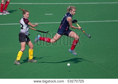 BLOEMFONTEIN, SOUTH AFRICA - AUGUST 7: Unidentified players during a womenâ??s field hockey match between the North West and Free State Universities, on Aug 7., 2010 in Bloemfontein, South Africa.