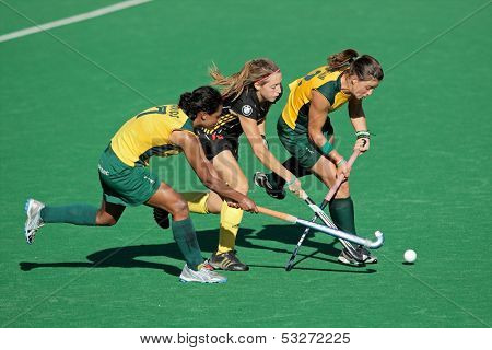 BLOEMFONTEIN, SOUTH AFRICA - FEBRUARY 7: I Davids (L), N Nelen(M), D Chamberlain (R) during a women's field hockey match between South Africa and Belgium, Bloemfontein, South Africa, 7 February 2011