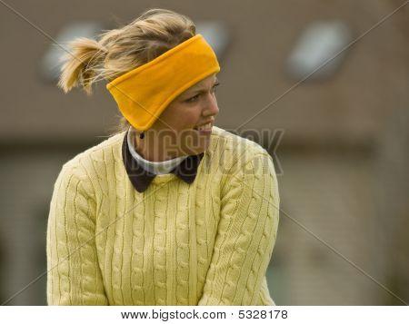 Female Collegiate Golfer Addressing The Golf Ball