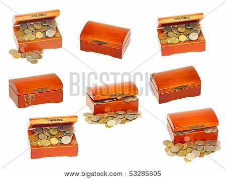 Set Of Old Wooden Treasure Casket With Money.isolated.