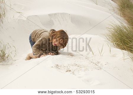 Boy Playing In The Dunes