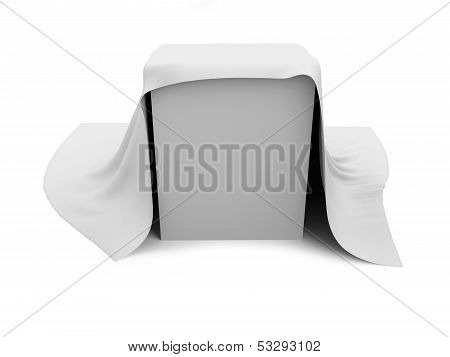White box covered with a white cloth