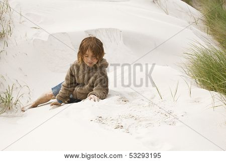Boy Sitting In The Dunes