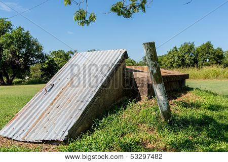 An Old Storm Cellar or Tornado Shelter in Rural Oklahoma.
