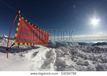 avalanche danger sign in snow, winter mountains