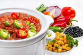 stock photo of pinto  - Pinto and garbanzo beans cooked in slow cooker with vegetables - JPG