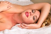 image of curvy  - Curvy young blonde woman nude in bed - JPG