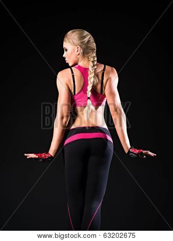 Athletic Strong Young Woman. Rear View