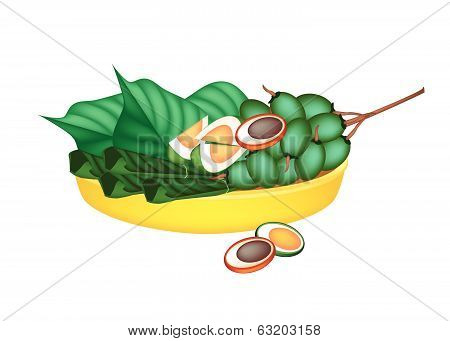 Ripe Areca Nuts And Betel Leaves On Gold Tray