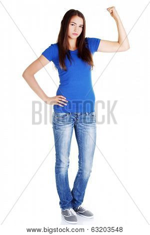 Young beautiful woman showing her strenght and muscle. Isolated on white.