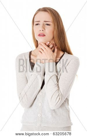 Beautiful casual woman is having sore throat. Isolated on white.
