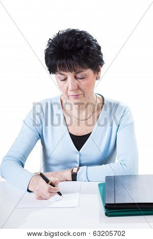 Accountant Wiriting By Desk
