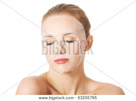 Beautiful woman with collagen mask on face. Isolated on white.