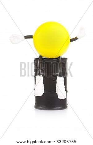 yellow little man sits on a flank with oil