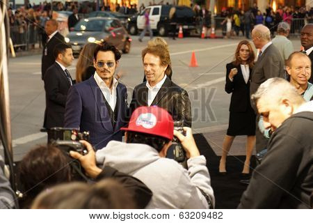 LOS ANGELES - APR 10: Johnny Depp, Jerry Bruckheimer at the premiere of 'Transcendence' at the Regency Village Theater on April 10, 2014 in Los Angeles, California