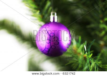 Christmas Ornament Hanging From A Xmas Tree Branch