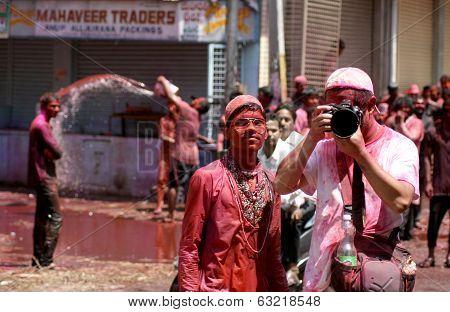 Tourist shoot Indian hindu celebration of Holi festival