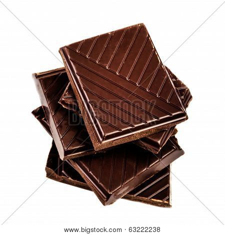 Chocolate Bars Stack Isolated On White Background Closeup.  Chopped Chocolate Bars Macro.