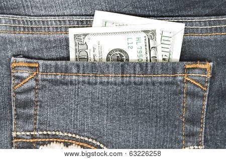 Money in your wallet in the back pocket of jeans