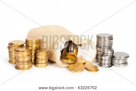 Stack of coins and money bag