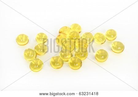 Close up of gelatin pills over white background