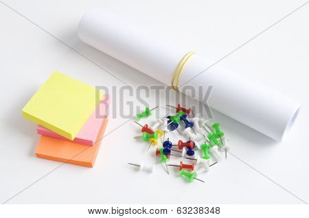 roll of paper with staples and sticker