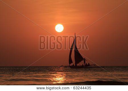 Traditional Sailboat at sunset