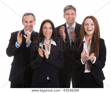 Portrait Of Happy Businesspeople Clapping