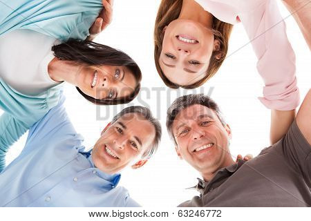 Happy People Making Huddle