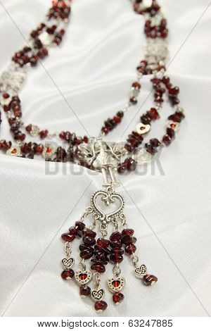 Necklace with a garnet