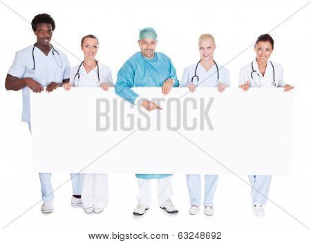 Group Of Multiracial Doctors Holding Placard